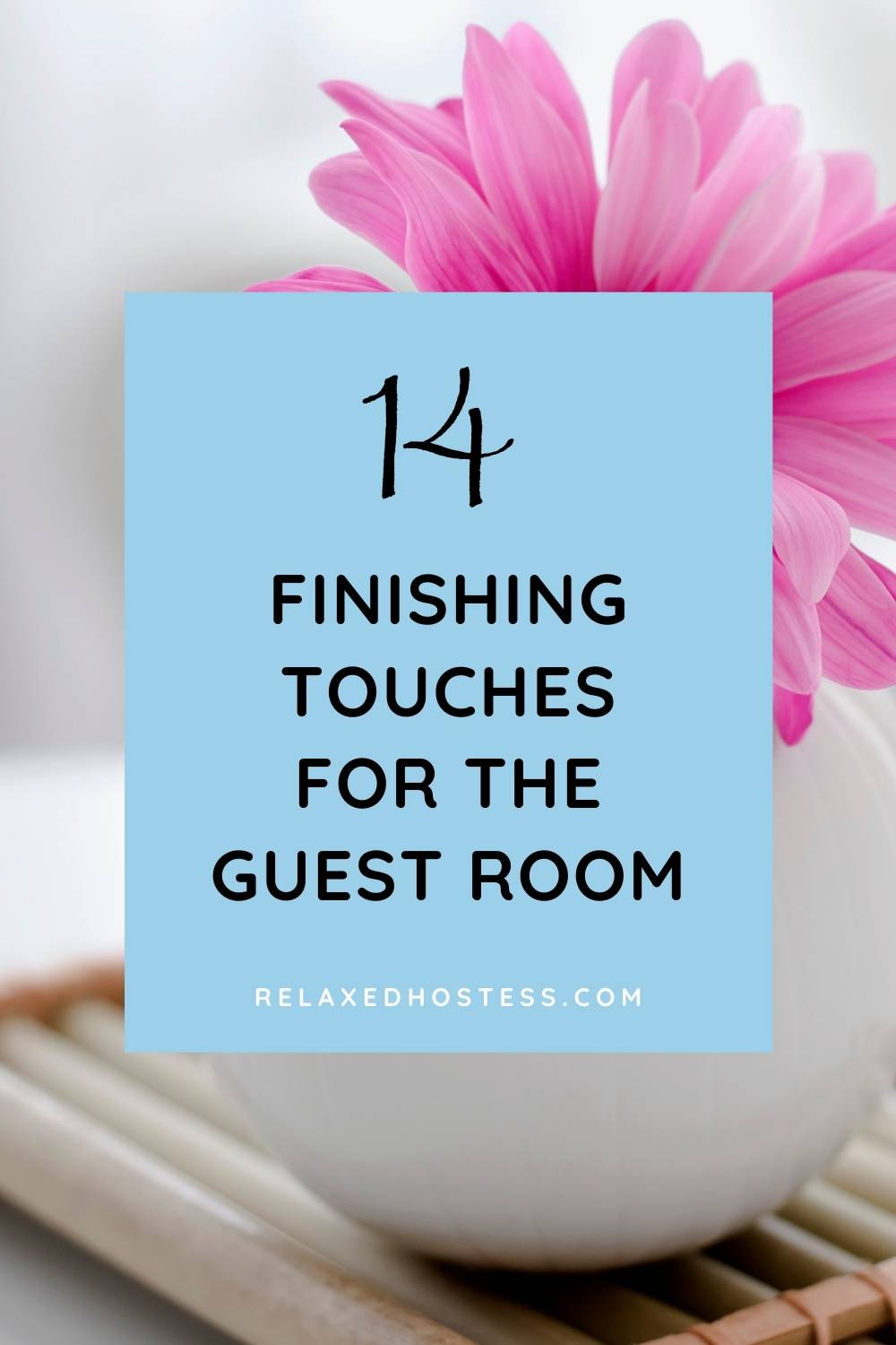 14 finishing touches for the guest room. RelaxedHostess.com. A pink flower in a white vase.