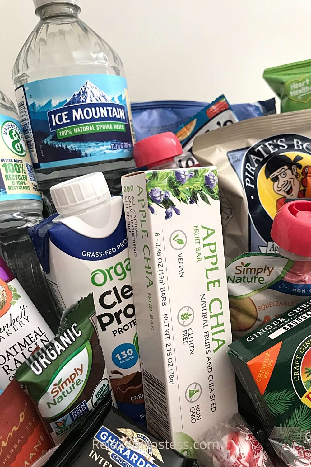Snack ideas for guestroom: water bottles, fruit bars, protein shake, granola bars, chocolate, fruit snacks, ginger candy,  peppermint, chips, popcorn, apple sauce...