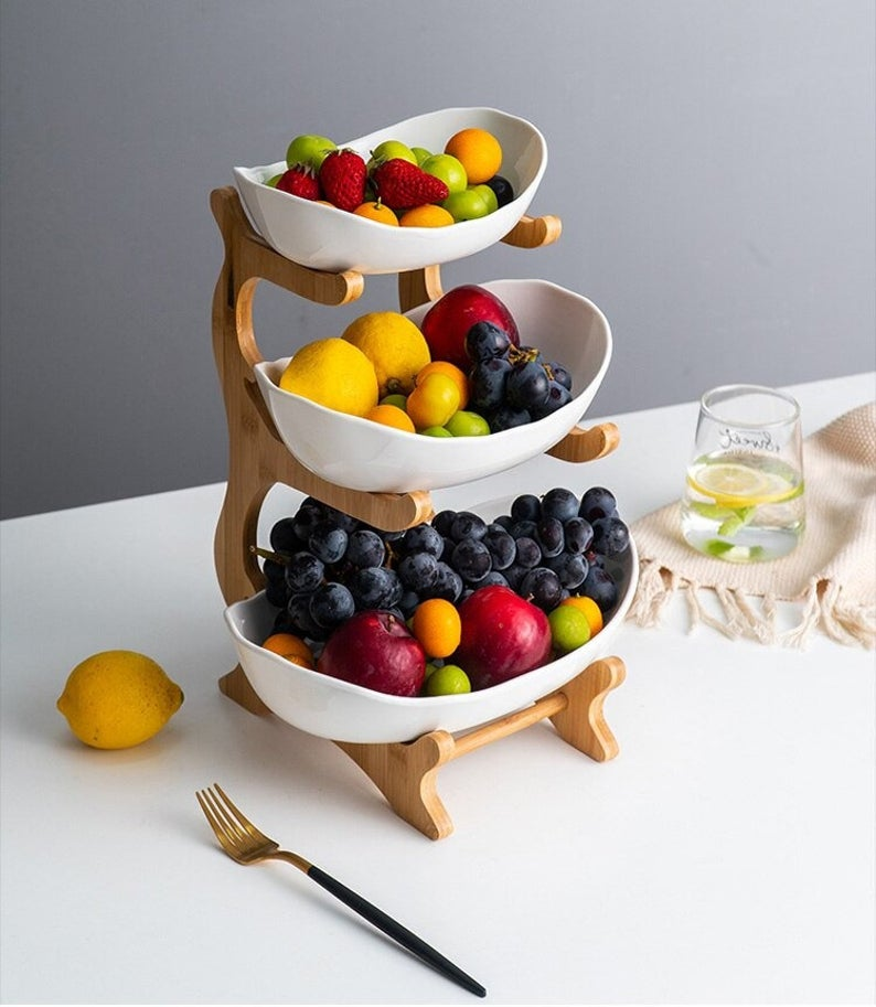 Bamboo serving stand (OhmyHomes, Etsy)