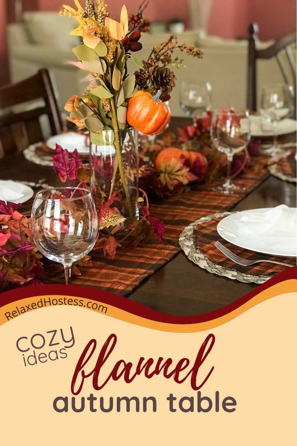 Flannel fall dinner table. Flannel table runner, round flannel place mats, white plates, wine glasses, autumn centerpiece.