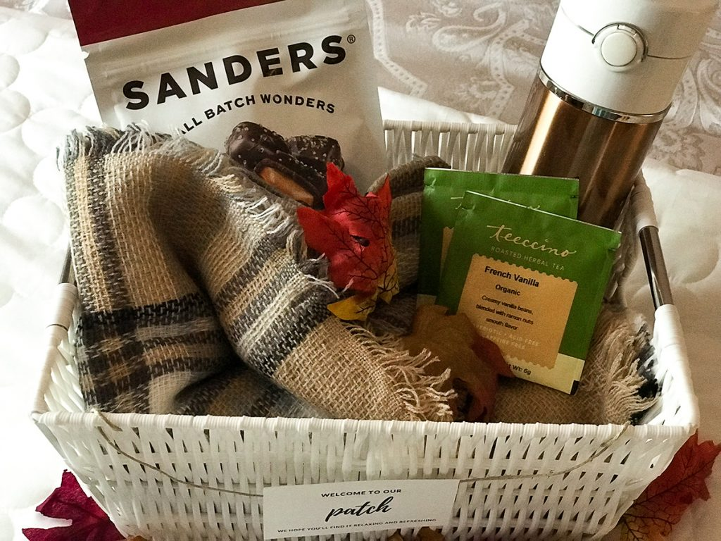 Fall Welcome Basket for House Guests. (RelaxedHostess.com) A plaid shawl, caramel filled dark chocolate, French Vanilla tea bags, copper thermos bottle.