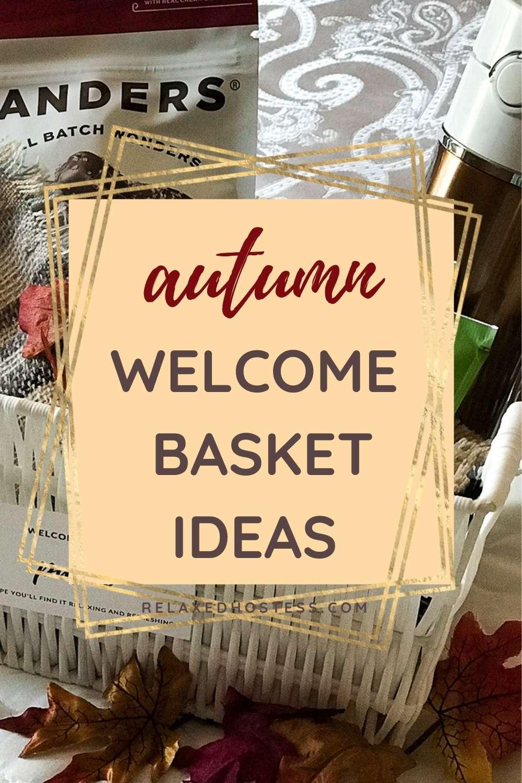 Fall Welcome Basket Ideas: white basket filled with goodies: dark chocolate sea salt caramel, plaid shawl, tea bags, thermos bottle.