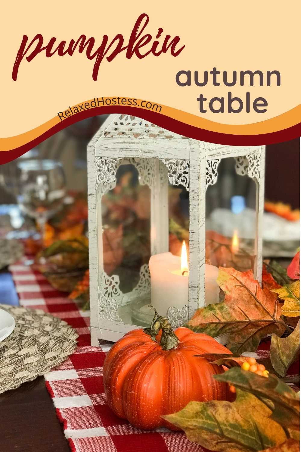 Easy pumpkin fall tablescape. Red and white checkered table runner, leaf garland, white washed lantern, pumpkins.