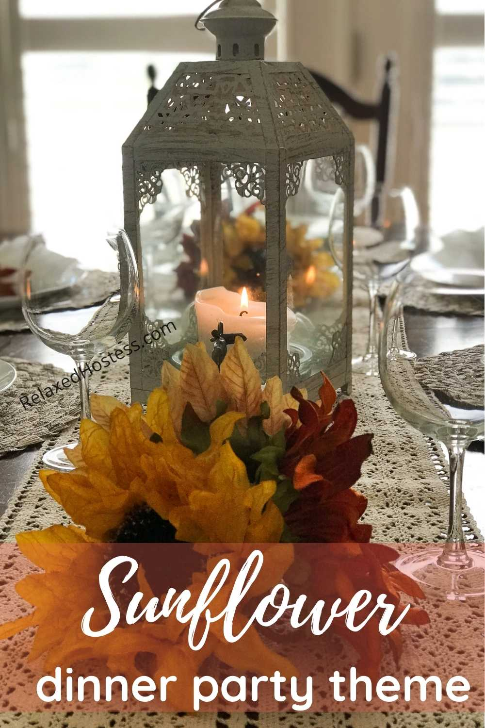 Sunflower Dinner Party Theme. A beige table runner, two sunflower arrangements, white-washed lantern